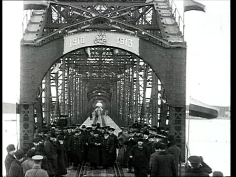 1913 montage b/w officials standing along railway track during ceremony for section of trans siberian railway built between 1910 and 1913/ russia - 1913 stock-videos und b-roll-filmmaterial