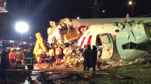 officials work at the site after a passenger plane skidded off the runway in istanbul sabiha gokcen international airport, on february 05, 2020 in... - istanbul province stock videos & royalty-free footage