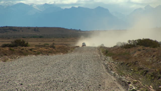 WS ZO Offroad rally car speeding on dirt road across desert / San Martin de Los Andes, Rio Negro, Argentina