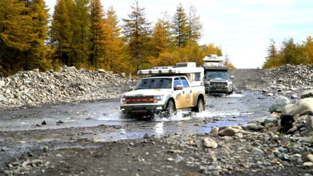 Off-Road Vehicle Crossing The River