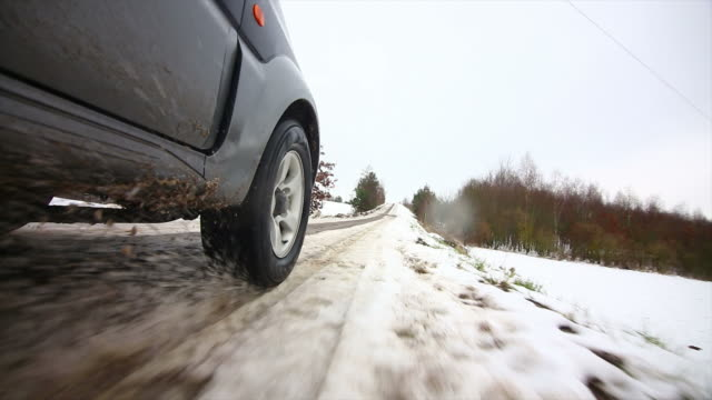 POV Off-road Vehicle Driving On Snow Slush Road