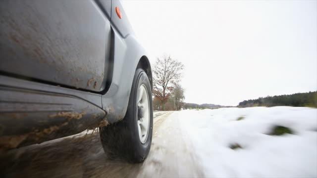POV Off-road Vehicle Driving On Snow Slush Road