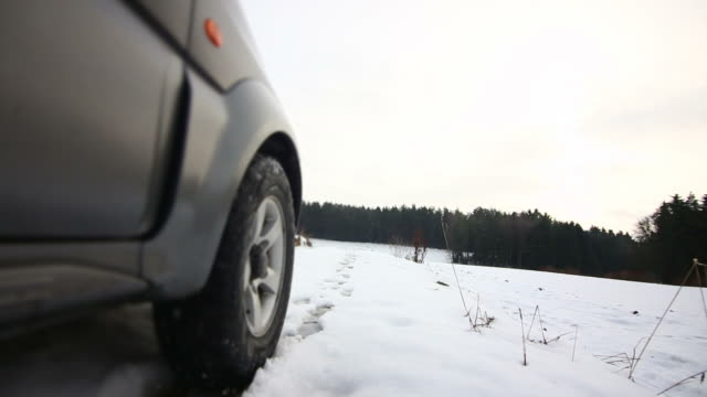 POV Off-road Vehicle Driving On Snowy Dirt Road