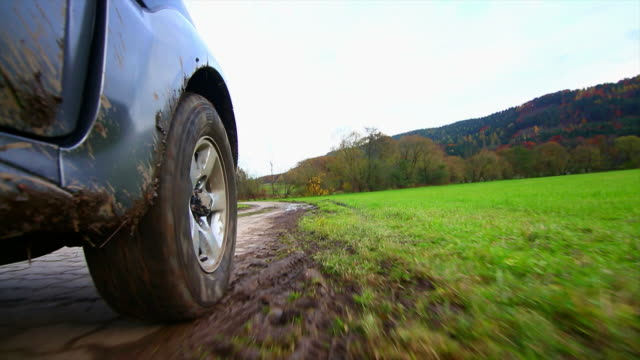 hd off-road vehicle driving through mud pov - off road car stock videos and b-roll footage