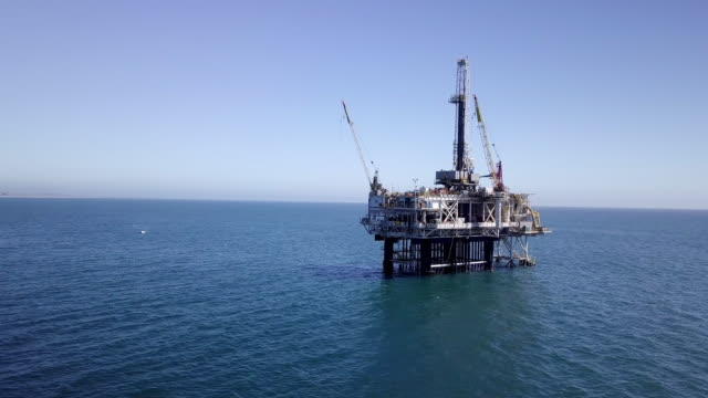 offshore fracking drilling rig in the pacific ocean - piattaforma offshore video stock e b–roll