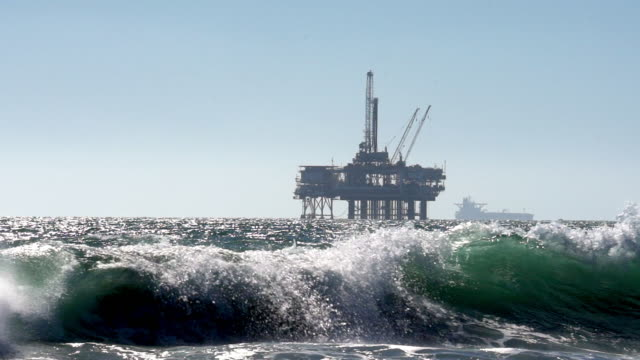 offshore fracking drilling rig in the pacific ocean - mineral stock videos & royalty-free footage