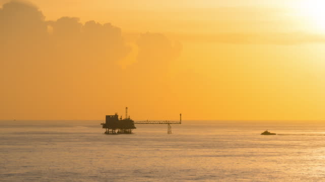 Offshore gas production platform time lapse from dusk to night