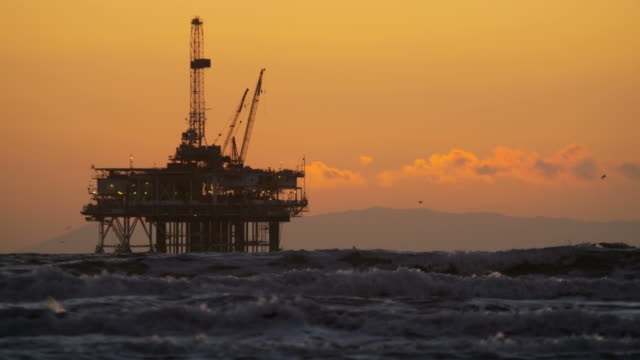 offshore industrial oil drilling platform at sunset usa - oil rig boat stock videos & royalty-free footage
