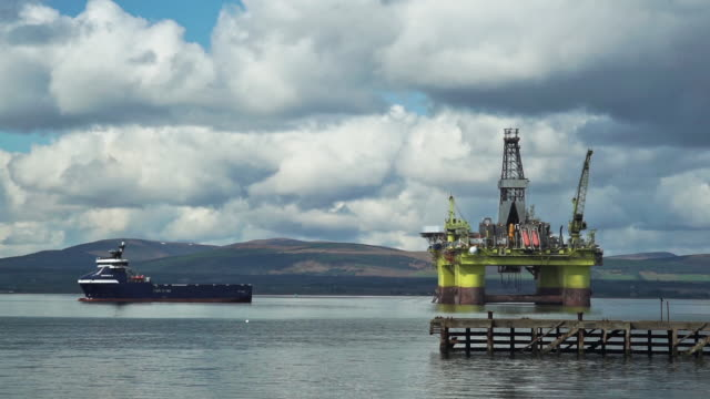 offshore oil platform with oil rig supply ship, port of nigg, scotland, uk - oil rig supply ship stock videos and b-roll footage