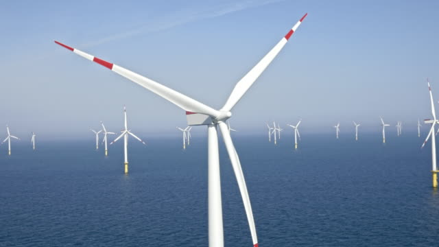 aerial offshore wind farm - wind power stock videos & royalty-free footage