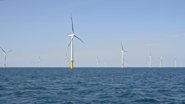 aerial offshore wind farm with rotating turbines - propeller stock videos & royalty-free footage