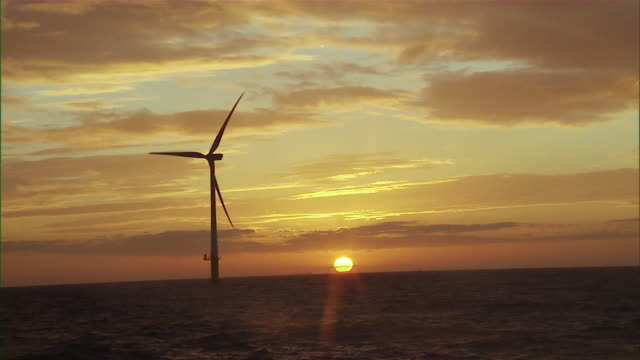 ws td offshore wind turbine turning slowly over waves of  ocean / merseyside, north sea, uk - north sea stock videos & royalty-free footage