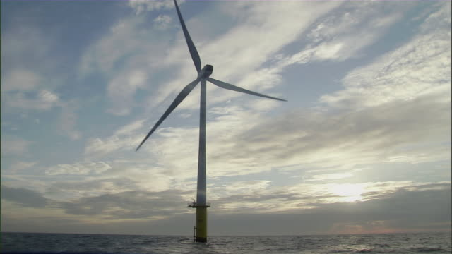 ws offshore wind turbine turning slowly over waves of  ocean / merseyside, north sea, uk - single object stock videos & royalty-free footage
