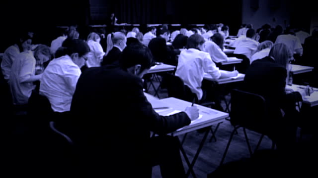 ofqual to 'look closely' at gcse english grades after concerns over unfair treatment graphicised sequence anonymus shot of schoolchildren sitting exam - general certificate of secondary education stock videos & royalty-free footage