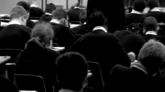 ofqual to 'look closely' at gcse english grades after concerns over unfair treatment; t08121106 date unknown: england: location unknown: int b/w... - b rolle stock-videos und b-roll-filmmaterial