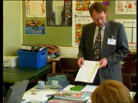 dumbing down fear lib warwickshire ofsted inspectors arriving at school inspectors discussing inspection in room in school inspector walking along... - warwickshire stock videos & royalty-free footage