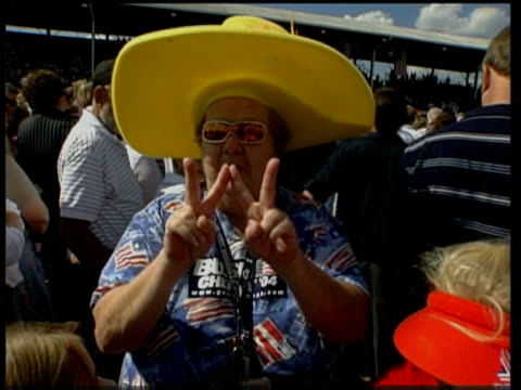 stockvideo's en b-roll-footage met ohio chillicothe female bush supporter making two v signs sot v for victory and w ms woman along with poster 'ross county for bush' pan la bv man... - chillicothe