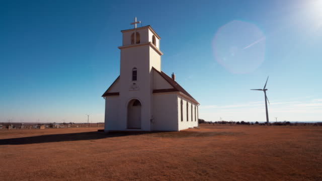 ohio church and wind farm medium - kirche stock-videos und b-roll-filmmaterial