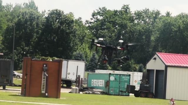ohio department of transportation conduct unmanned aerial vehicle training at the ohio fire academy, reynoldsburg, ohio for exercise vigilant guard... - ラジコン点の映像素材/bロール