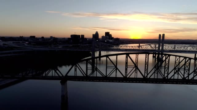 ohio river view of louisville kentucky at sunset - kentucky stock videos & royalty-free footage