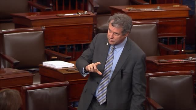 Ohio Senator Sherrod Brown directly engages Senate Finance Committee Chairman Orrin Hatch of Utah during debate on the Tax Cuts and Job Act over...
