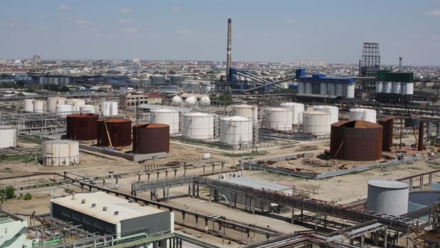 Oil and fuel storage tanks stand at the Atyrau oil refinery operated by KazMunaiGas National Co in Atyrau Kazakhstan on Thursday July 2 2015 Shots...