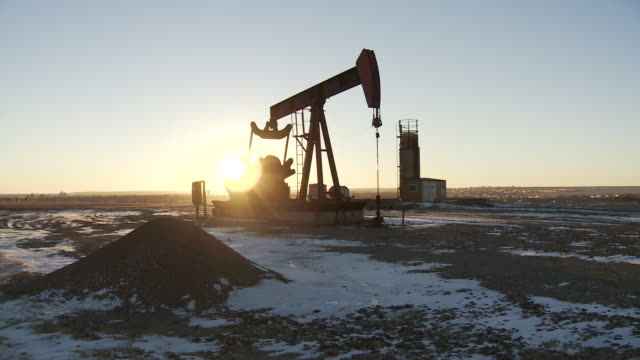 Oil and gas fracking and drilling rig/pump jack in Williston, North Dakota.