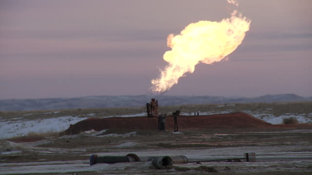 oil and gas fracking and drilling rig/pump jack in williston, north dakota. - fracking stock videos and b-roll footage