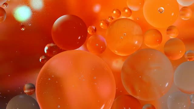 öl-bubble orange hintergrund - orange farbe stock-videos und b-roll-filmmaterial