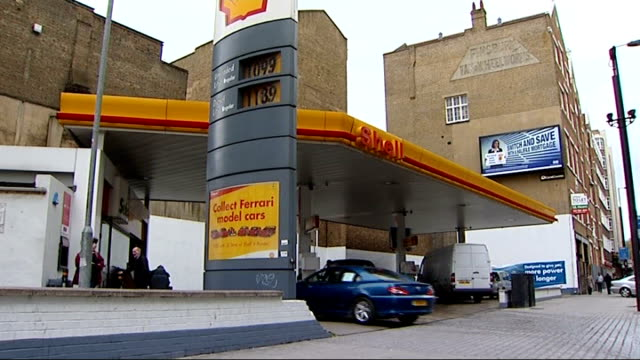 stockvideo's en b-roll-footage met oil company goes into administration / essex refinery shut down london ext general view of shell petrol station - shell merknaam
