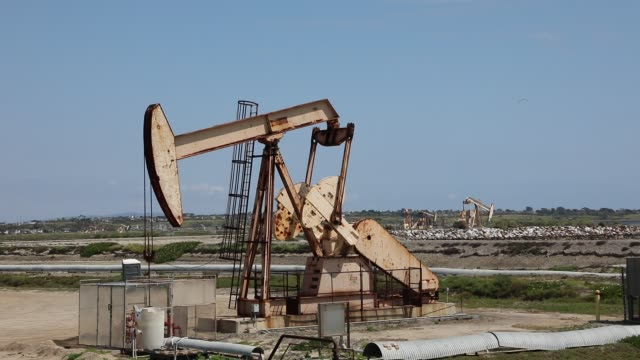 oil derricks are seen at the huntington beach, california oil fields on april 20, 2020 in huntington beach, california. oil prices traded in negative... - oil stock videos & royalty-free footage