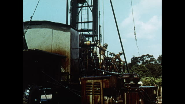 montage oil drilling in brunei - 石油産業点の映像素材/bロール