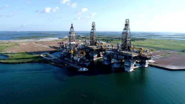 oil drilling platform being deconstructed on an island on the texas gulf coast - drill stock videos & royalty-free footage