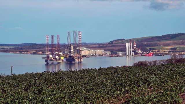 oil drilling platforms in port of nigg cromarty firth scotland uk - gas stock videos & royalty-free footage