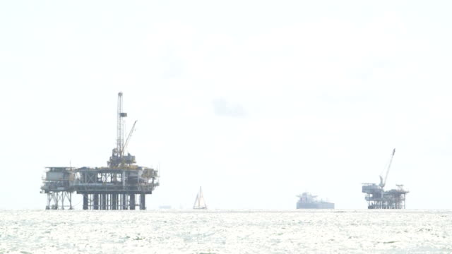Oil Drilling Rigs with Sail Boat