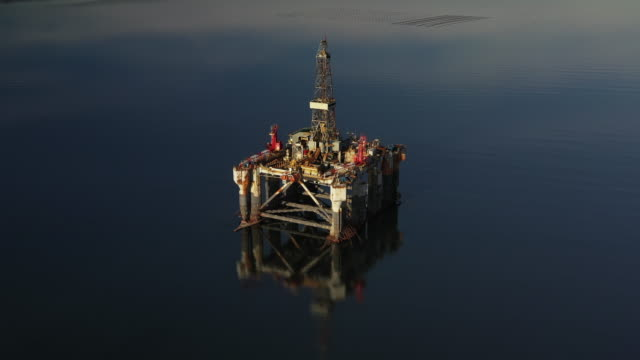 oil exploration platform in a sea channel filmed by drone, cromarty firth, scotland, united kingdom - construction machinery stock videos & royalty-free footage