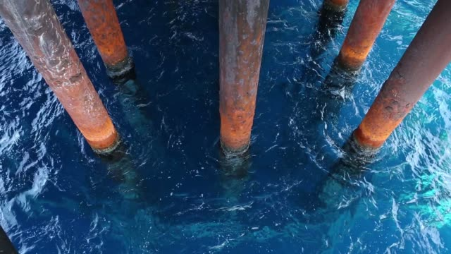 oil extraction pipes emerge from the water at the casablanca oil platform operated by repsol sa in the mediterranean sea off the coast of tarragona... - drill stock videos & royalty-free footage