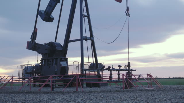 oil field pump in sunrise - absence stock videos & royalty-free footage