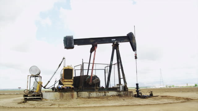 oil field pumpjack in california - pulley stock videos & royalty-free footage