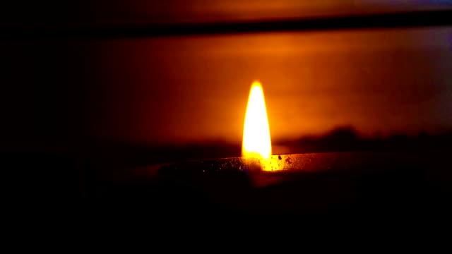 Oil lamp burning in hindu temple, India