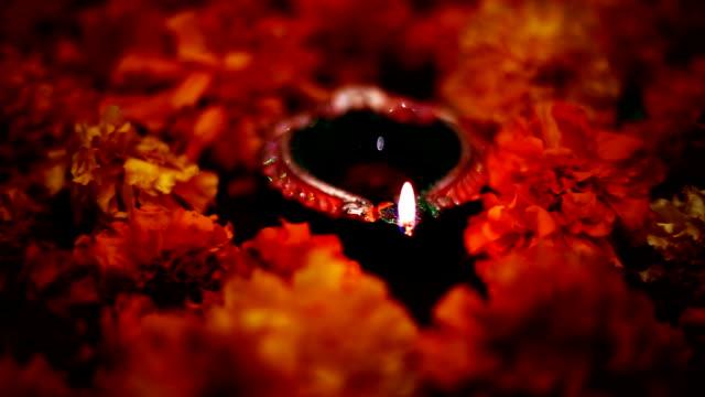 oil lamp in marigold flowers - glowing stock videos & royalty-free footage