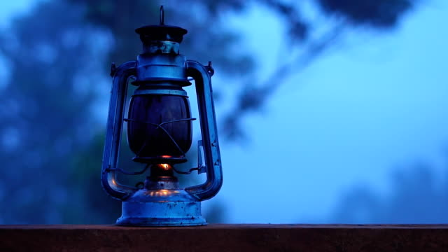 oil lamp lit at night in the forest. - lantern stock videos & royalty-free footage