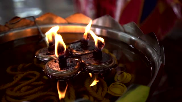 Oil Lamp with Flame in Thai Temple in Slow Motion.
