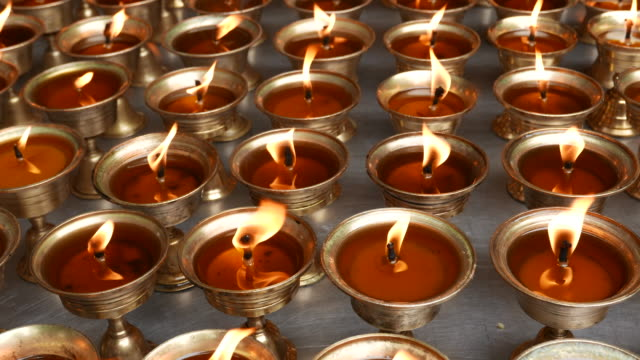 oil lamps in temple - buddhism stock videos & royalty-free footage