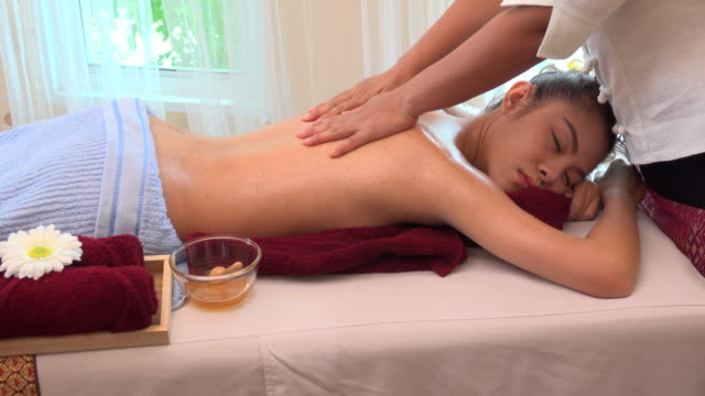 oil massage in spa - massager stock videos and b-roll footage