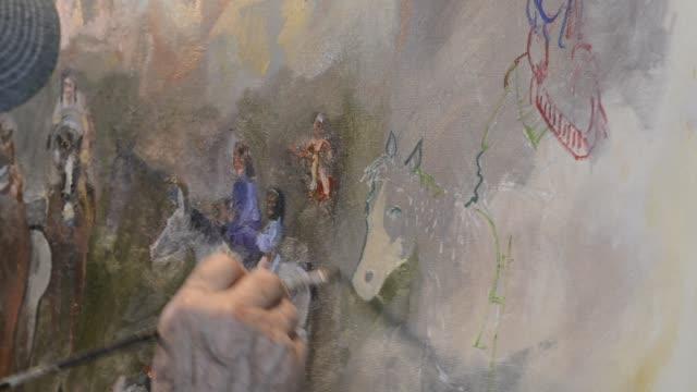oil painting including horses - tela di canapa video stock e b–roll