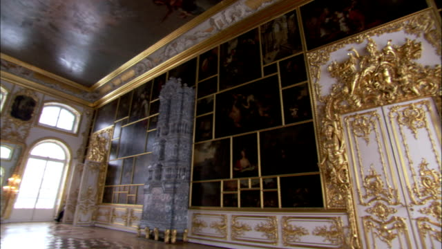 Oil paintings and arched windows line the walls of The Picture Room in the Catherine Palace. Available in HD.
