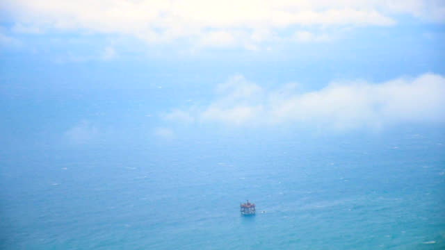 aerial  oil platform in stormy sea - oil rig boat stock videos & royalty-free footage