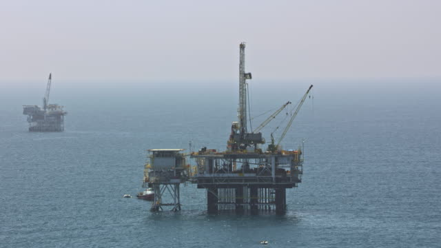 aerial oil platforms in the ocean in california - oil rig boat stock videos & royalty-free footage