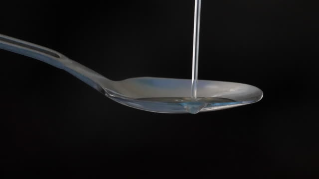 oil pouring on spoon - spoon stock videos & royalty-free footage